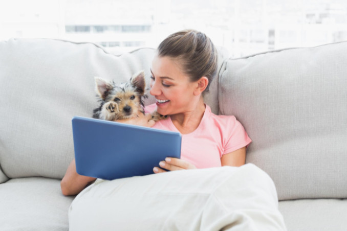 Dog on couch with owner: Richmond's Indoor Air Quality Blog