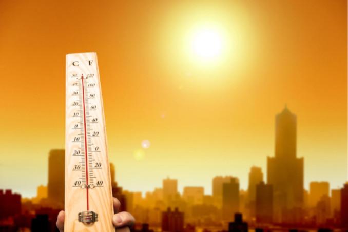 Temperature rising against cityscape: Richmonds AC Repair Blog