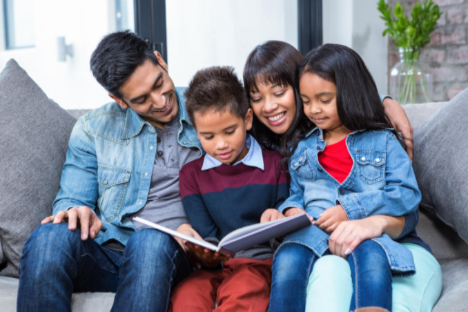 Family reading book on couch: Richmond's Energy Savings Blog