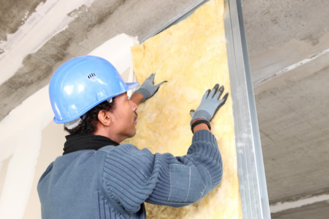 man fitting insulation: Richmond's Air Indoor Comfort Systems blog