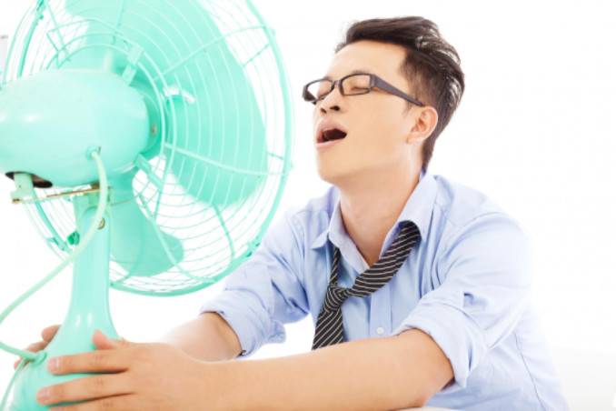 man with fan: Richmond's Air Indoor Comfort Systems blog